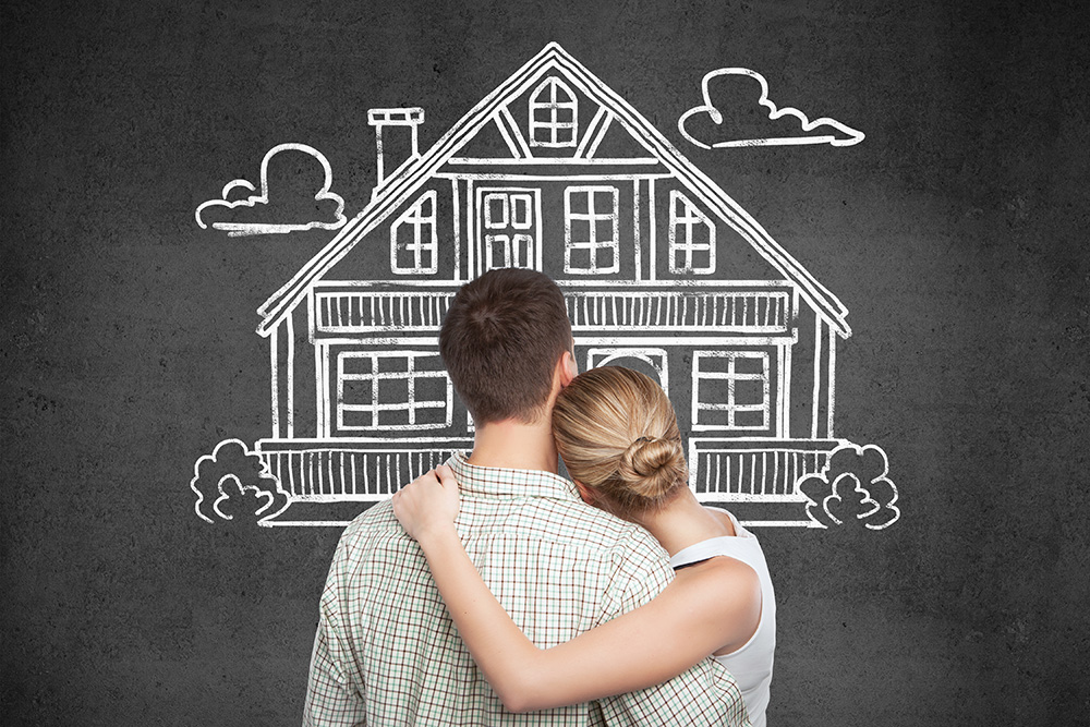 Back view of young couple looking at house sketch on dark concrete background