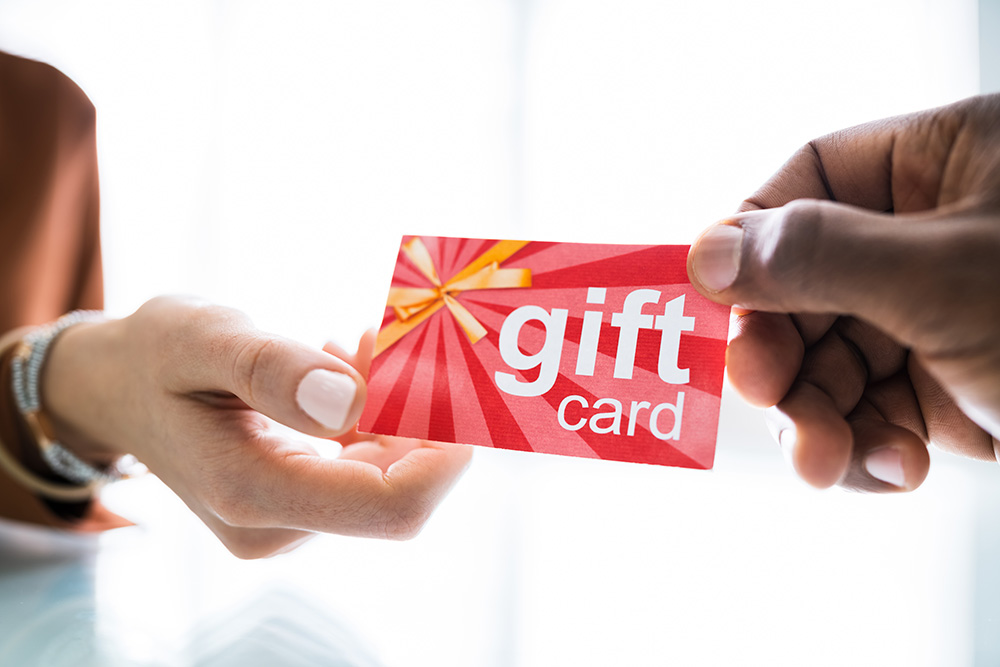 Customer being handed a gift card