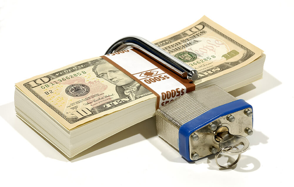 Stack of Money with a Lock and Key
